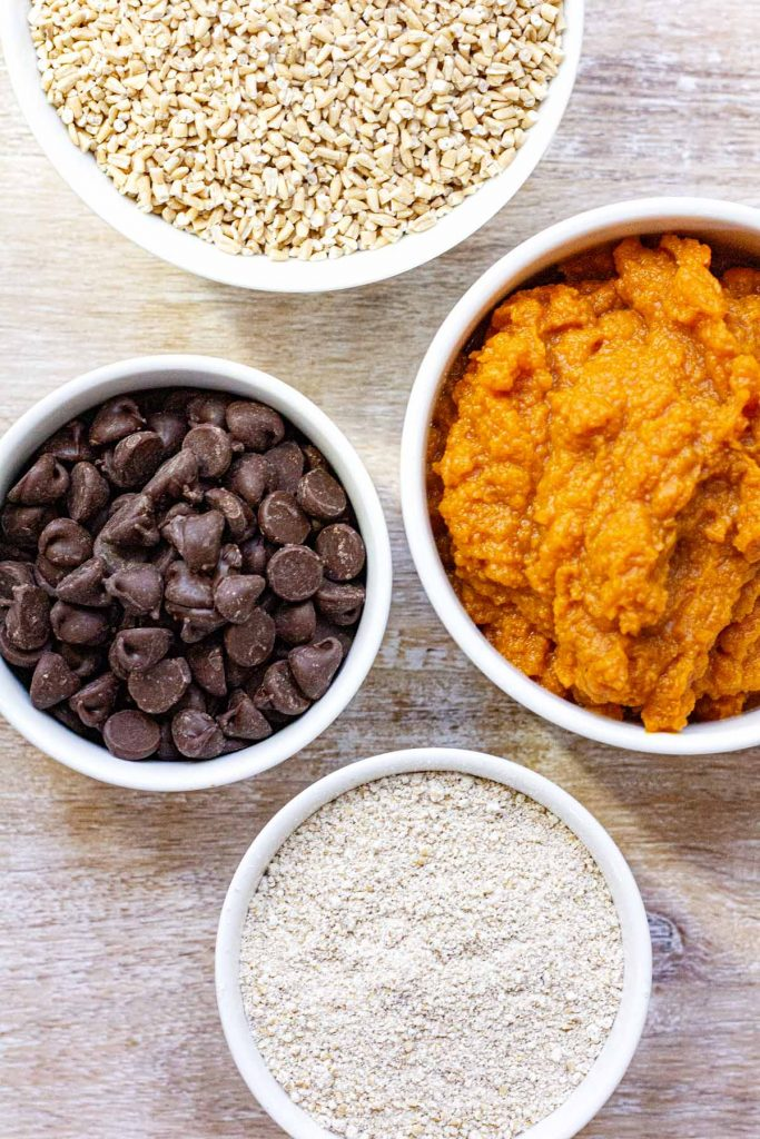 Some of the ingredients for Pumpkin Chocolate Chip Muffins including steel cut oats, semi sweet chocolate chips, pumpkin puree.